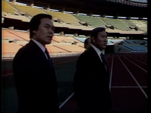 preparations for 1988 seoul olympics continues; itn / after election south korea: seoul stadium: ext cms track l-r side tae-woo along with men during... - olympische spiele stock-videos und b-roll-filmmaterial