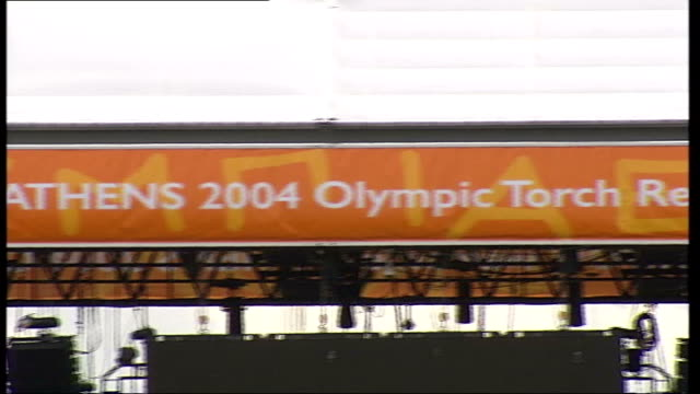 preparations for arrival in london of olympic torch itn london the mall ext i/c la gv sign 'london welcomes athens 2004 olympic torch relay' pan ls... - olympic torch stock videos & royalty-free footage