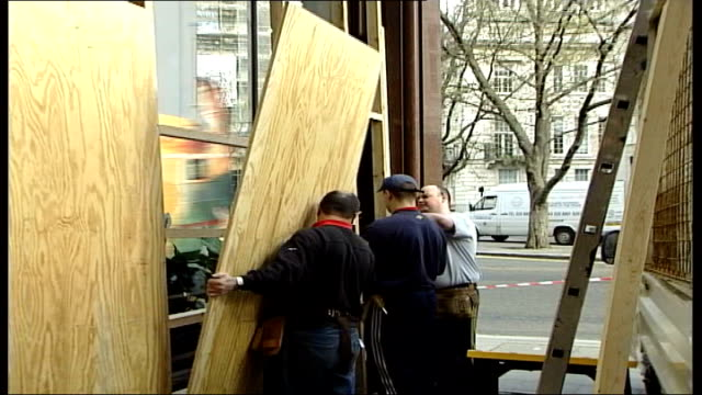 preparations for may day protests in london england london ext workmen boarding up windows of the national lottery headquarters - {{asset.href}} stock videos & royalty-free footage
