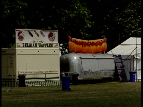 preparations for o2 wireless festival sign reading 'bar workers beer co' / wide view of bar tent pan to other structures / closed up food stalls /... - festival poster stock videos & royalty-free footage