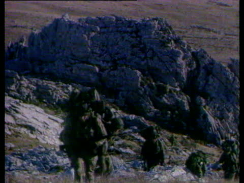preparations for the final push to port stanley / distant views of firing near the front line / soldiers marchigng through rocky terrain / soldiers... - 1982 stock videos & royalty-free footage