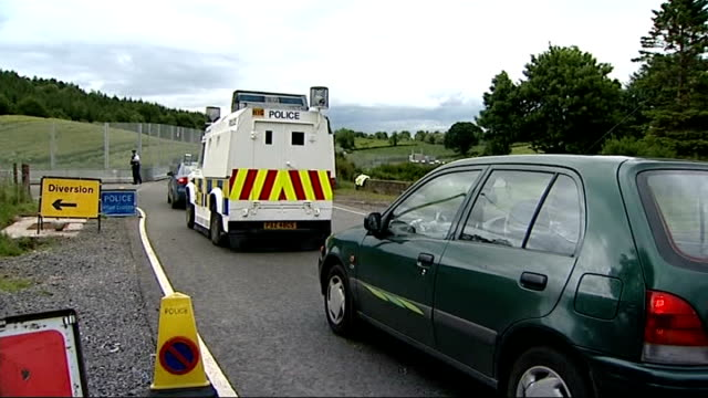 preparations in enniskillen ahead of g8 summit police officers monitoring checkpoint / officer with arm raised / officer speaking to car driver /... - gun belt stock videos and b-roll footage