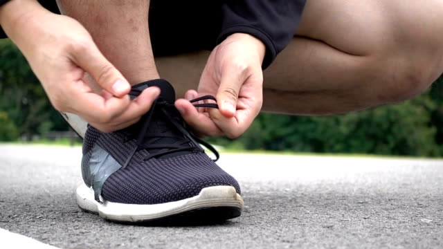 prepare for running - shoe stock videos & royalty-free footage