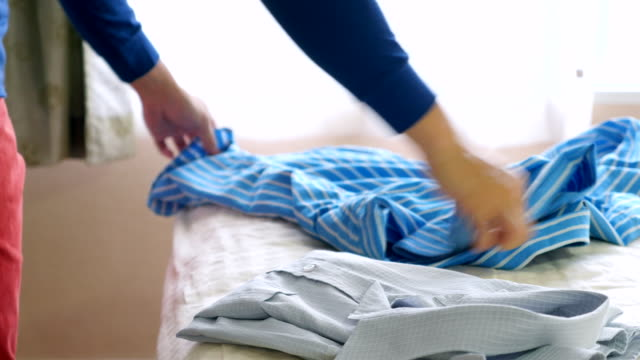 prepare shirt for traveling - laundry stock videos & royalty-free footage