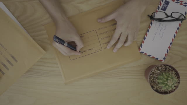 prepare to send a letter - package stock videos and b-roll footage