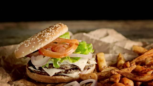 SLO MO DS Preparing a delicious double hamburger and crispy potato wedges