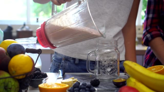 preparing a fresh healthy smoothie - smoothie stock videos & royalty-free footage