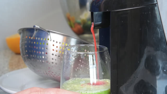 preparing a healthy juice with berries - brambleberry stock videos & royalty-free footage