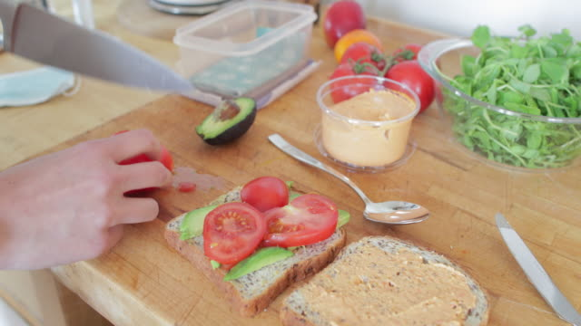 preparing a vegatarian sandwhich for a packed lunch - packed lunch stock videos & royalty-free footage