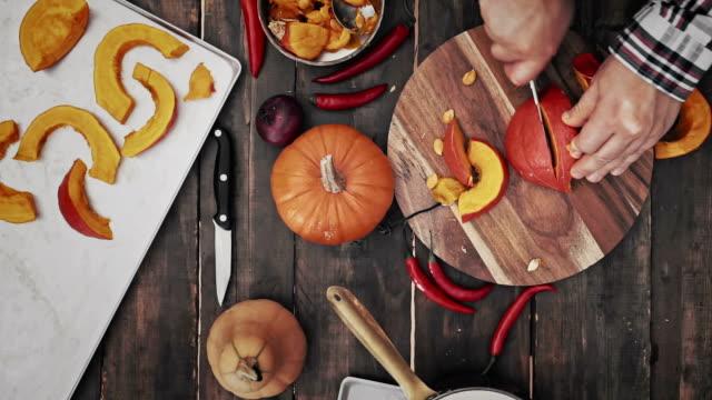 preparing and cutting fresh pumpkins - pumpkin stock videos & royalty-free footage