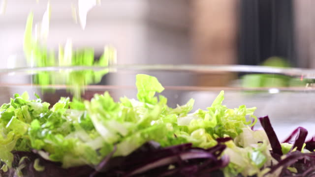 preparing and mixing fresh root vegetable salad - root vegetable stock videos and b-roll footage