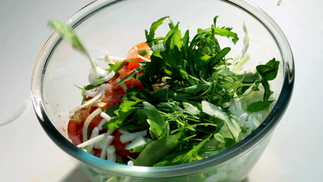 preparing and mixing salad in a bowl. - scallion stock videos & royalty-free footage