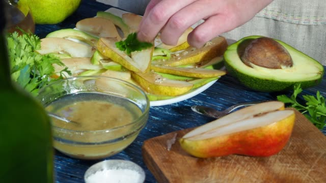 preparing avocado and pear salad - parsley stock videos and b-roll footage