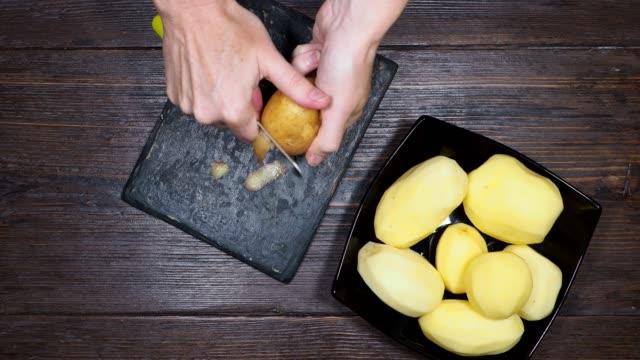 preparing baked potato - peel stock videos & royalty-free footage