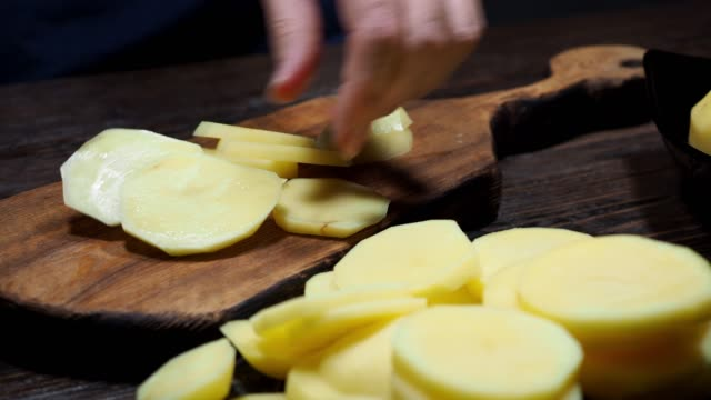 preparing baked potato - baked potato stock videos & royalty-free footage