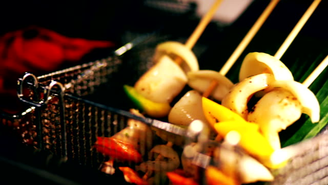 Preparing BBQ grille veggie skewers for the grill.