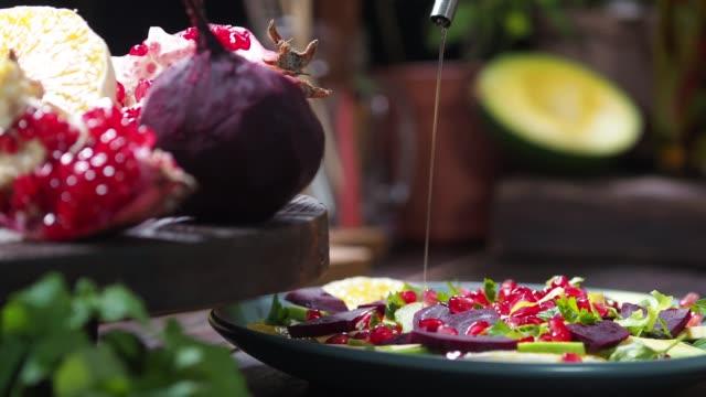 preparing beet and orange salad - beet stock videos & royalty-free footage