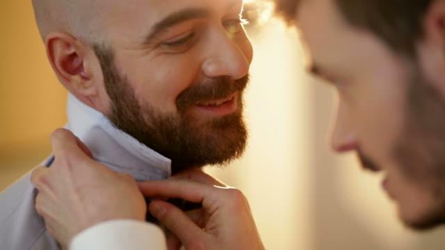 preparing boyfriend for gay wedding - gay rights stock videos & royalty-free footage