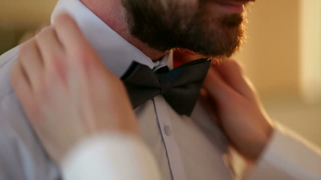 stockvideo's en b-roll-footage met preparing boyfriend for gay wedding - shirt and tie
