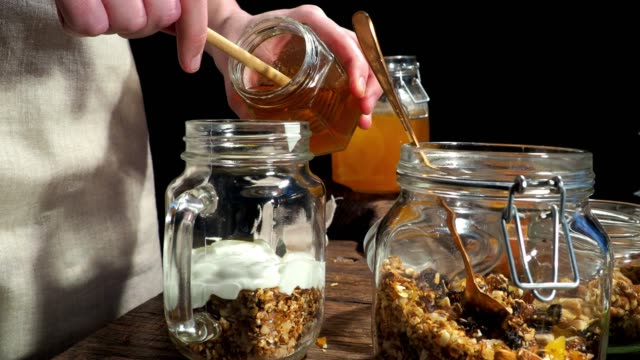 preparing breakfast with homemade granola - sour cream stock videos and b-roll footage