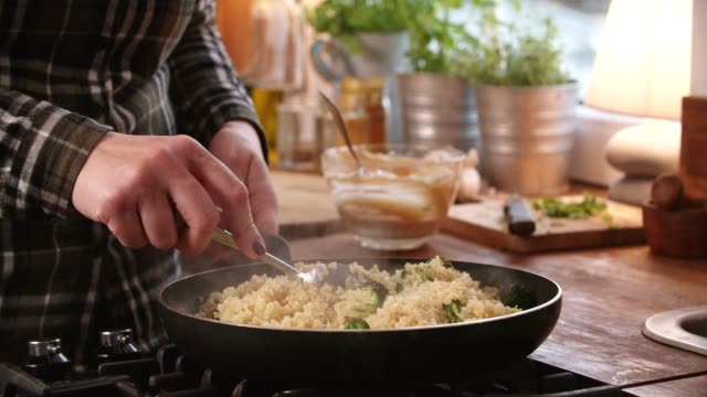 preparing bulgur with broccoli and harissa yogurt - quinoa salad stock videos & royalty-free footage