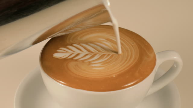 preparing cappuccino coffee - froth art stock videos and b-roll footage