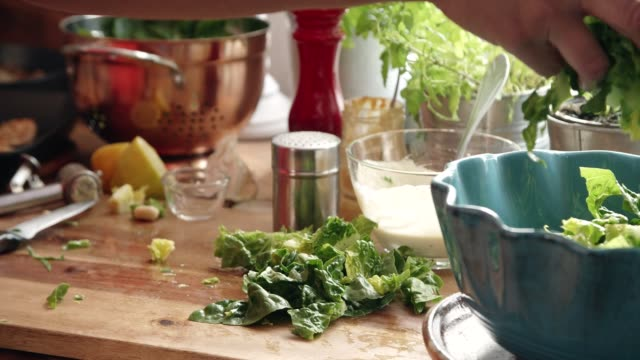 preparing cesar salad with chicken, lettuce and parmesan - parmesan stock videos & royalty-free footage