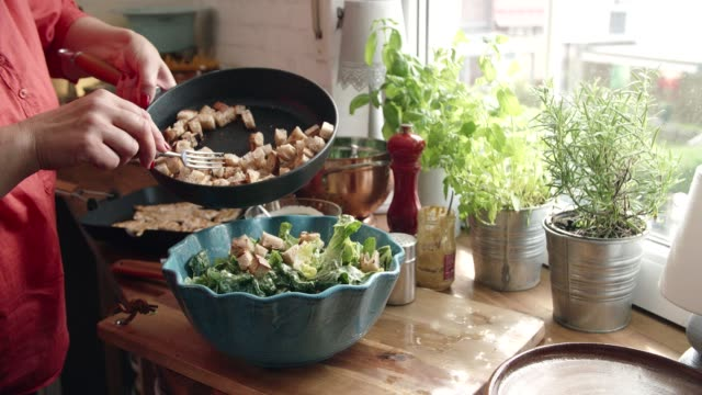preparing cesar salad with chicken, lettuce and parmesan - grilled chicken stock videos and b-roll footage