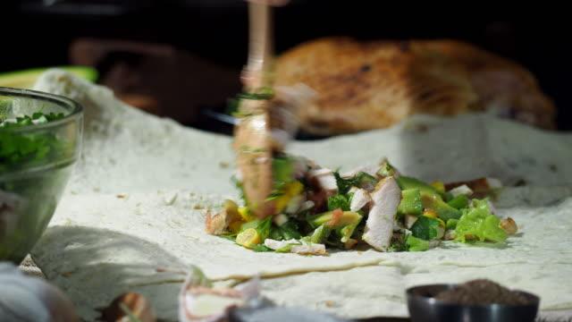preparing chicken avocado wraps - parsley stock videos and b-roll footage