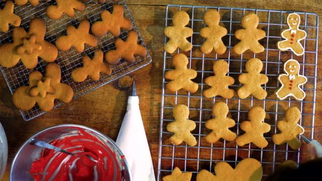vídeos de stock e filmes b-roll de preparing christmas cookies in domestic kitchen - domestic kitchen