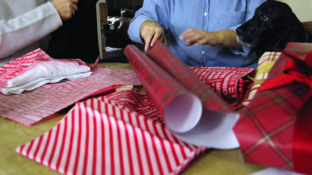 preparing christmas gifts - christmas wrapping paper stock videos & royalty-free footage