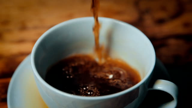 preparing coffee,pouring in cup - coffee cup stock videos & royalty-free footage