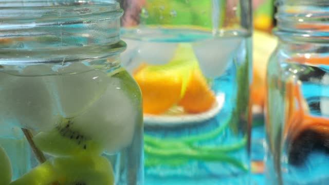 preparing cold drinks with fruits and vegetables - plank variation stock videos & royalty-free footage