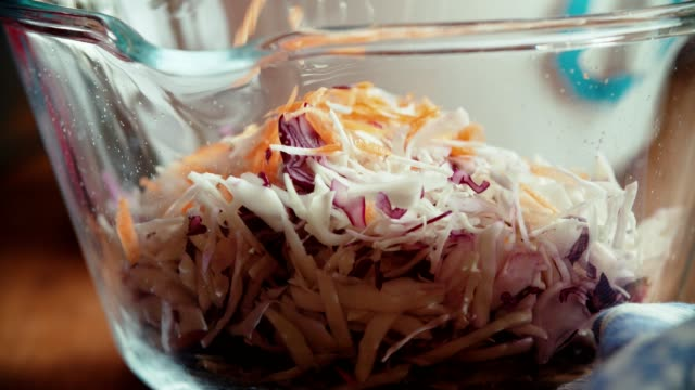 preparing cole slaw salad in domestic kitchen - coleslaw stock videos & royalty-free footage