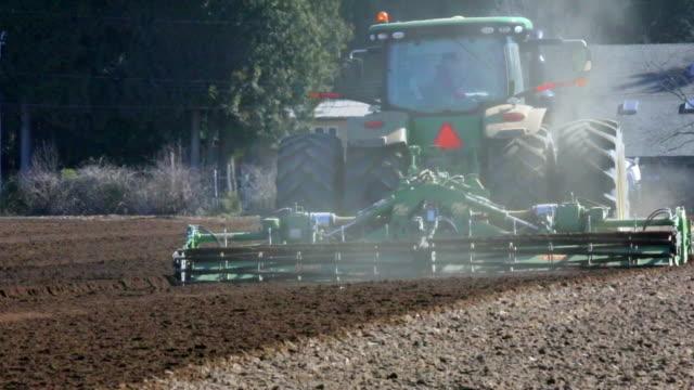 preparing cornfields in the springtime heat - plowed field stock videos & royalty-free footage