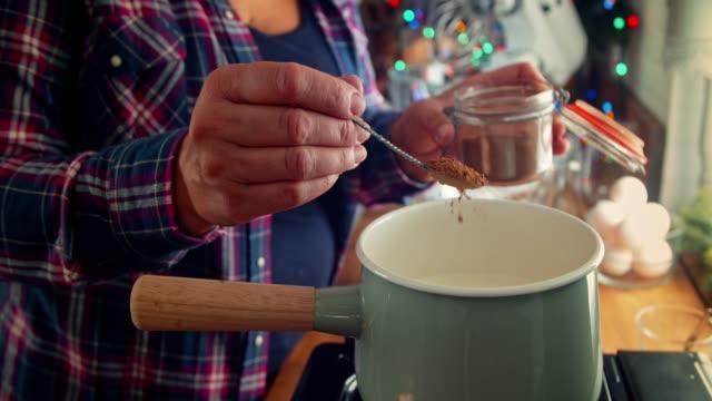 preparing creamy eggnog with cinnamon for christmas - cinnamon stock videos & royalty-free footage