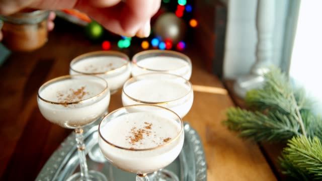 preparing creamy eggnog with cinnamon for christmas - crockery stock videos & royalty-free footage