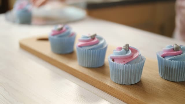 preparing cupcake for birthday party - decoration stock videos & royalty-free footage