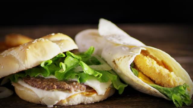 SLO MO DS Preparing delicious hamburger and chicken wrap