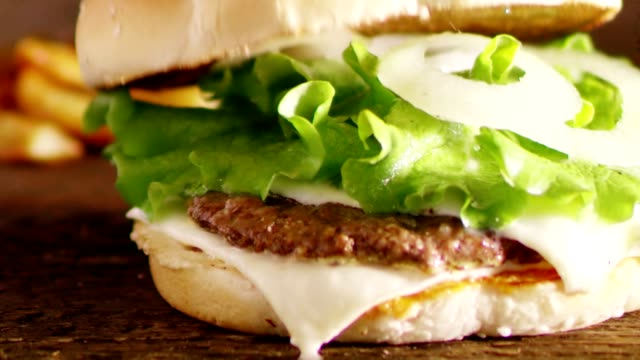 slo mo ds preparing delicious hamburger - hamburger stock videos & royalty-free footage