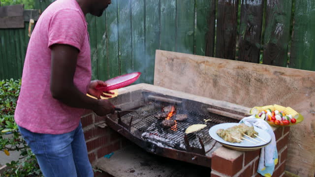 preparing dinner outdoors - flammable stock videos & royalty-free footage