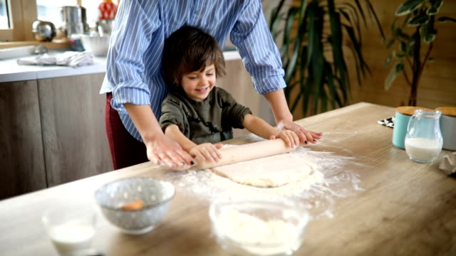 preparing dough for biscuits - rolling pin stock videos & royalty-free footage