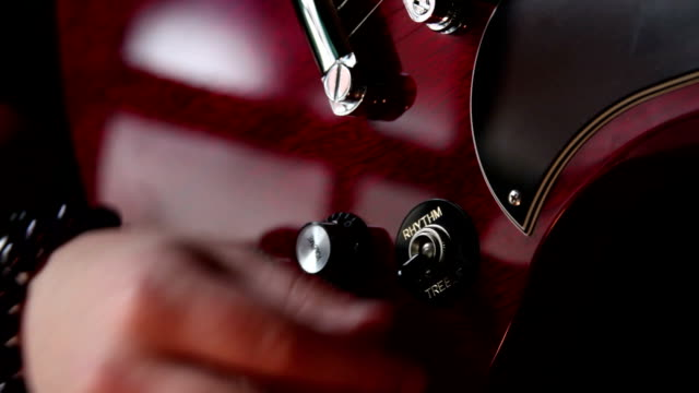 preparing electric guitar for stage - knob stock videos and b-roll footage
