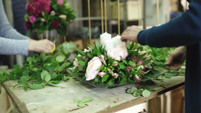 preparing floral arrangement for special occasion - flower arrangement stock videos & royalty-free footage