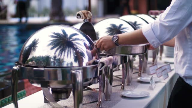 preparing food at wedding ceremony - buffet stock videos & royalty-free footage