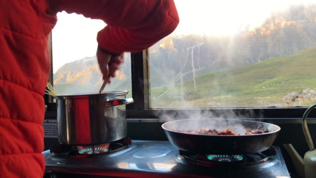 Preparing food in the mountain hut