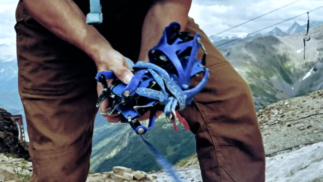 preparing for a climb. caucasus mountains. equipment details - climbing equipment stock videos and b-roll footage