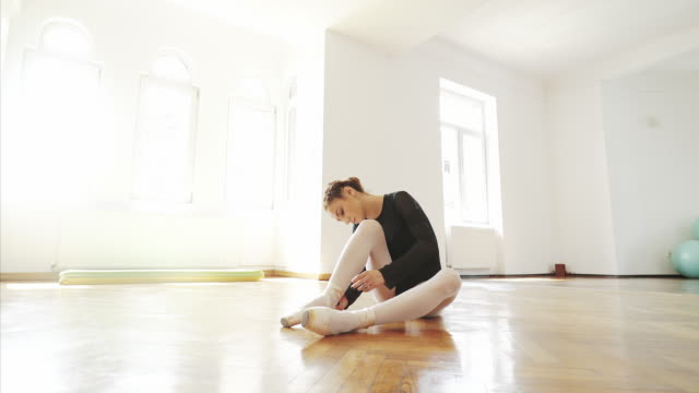 preparing for a new exercise session. - ballet shoe stock videos and b-roll footage