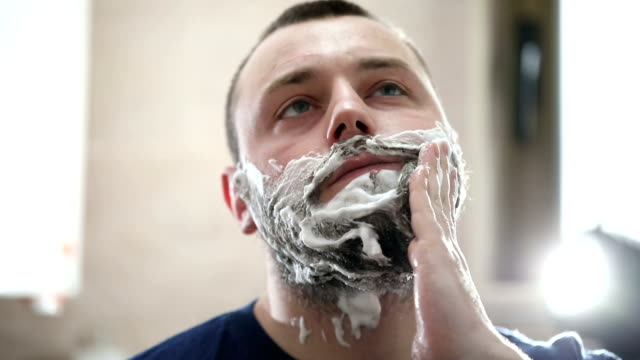 preparing for a shave - one man only stock videos & royalty-free footage