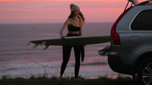 preparing for an early surf - surfboard stock videos & royalty-free footage